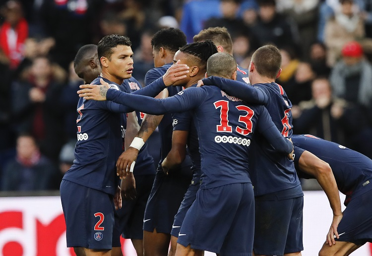 PSG's players celebrate after scoring the opening goal during the French League One soccer match between Paris Saint-Germain and Bordeaux at the Parc des Princes stadium in Paris, Saturday, Feb. 9, 2019. (AP Photo/Christophe Ena)