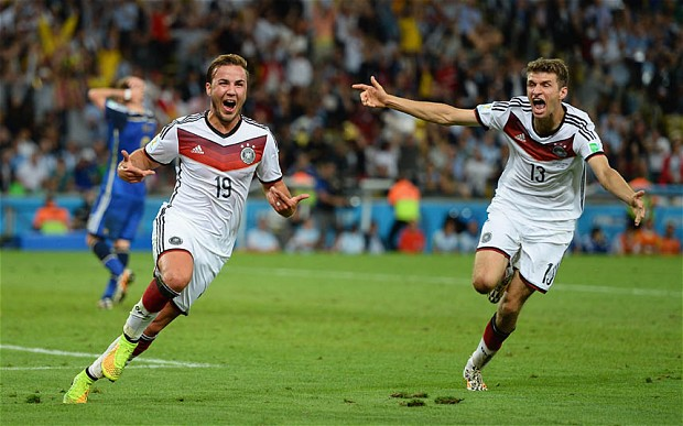 RIO DE JANEIRO, BRAZIL - JULY 13: Mario Goetze of Germany (L) celebrates scoring his team's first goal with Thomas Mueller during the 2014 FIFA World Cup Brazil Final match between Germany and Argentina at Maracana on July 13, 2014 in Rio de Janeiro, Brazil. (Photo by Jamie McDonald/Getty Images)